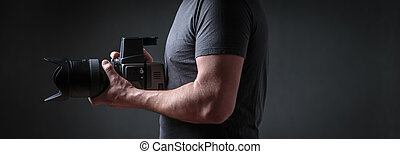 Photographer with a medium format camera in his studio