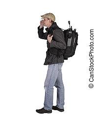 Photographer with backbag and tripod
