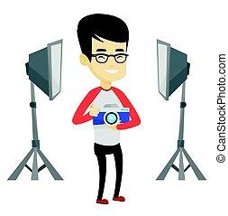 Photographer with camera in photo studio.