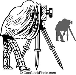 Photographer with his photocamera on a tripod