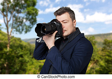 Photographer with photo camera takes the picture