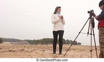 photographer woman backstage girl man photographs the...