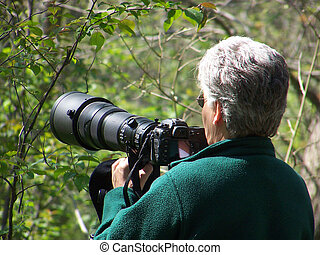 Photographer - Woman photographer with long telephoto lens
