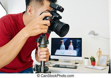 Photographer working in small studio