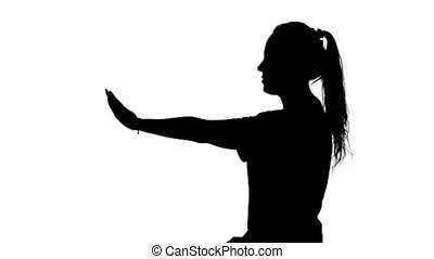 Photographer works in the studio. White. Silhouette