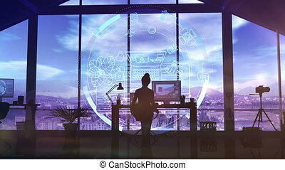 Photographer works with computer graphics. - Silhouette of a...