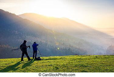 photographers on workshop at sunrise. capturing gorgeous...