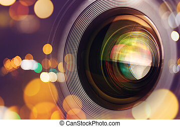 Photographic camera lens front glass with bokeh light, macro shot