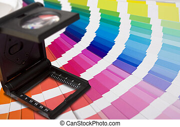 photographic magnifying lupe and colour swatches
