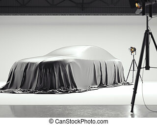 Photographic studio with covered car and several light sources. 3d rendering