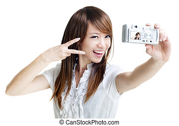 Photographing - Asian girl self photographing, isolated on ...