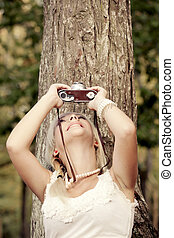 Photographing - Beautiful young girl taking pictures with a ...