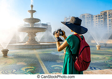 Photographing central fountain in Bucharest city