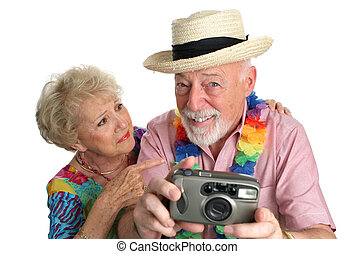 Photographing Girls On Beach - A senior man with a camera ...