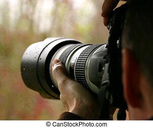Man photographing nature with nice lens.