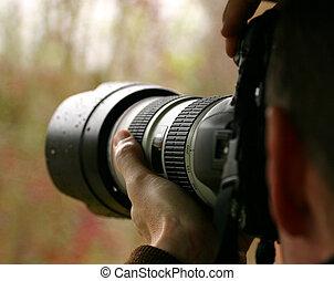 Photographing Nature - Man photographing nature with nice...