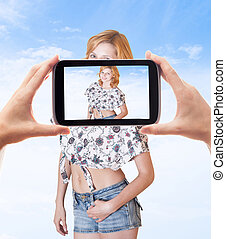 photographing smartphone beautiful girl in shorts