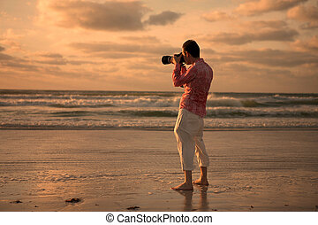Photographing Sunset - A photographer taking a picture of ...