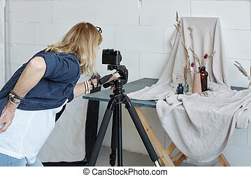 Photographing vase composition in studio