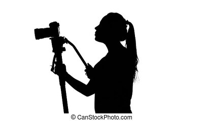 Photographing with a tripod. White. Silhouette - Young...
