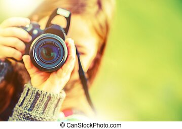 Photography Hobby. Girl with Modern Digital Interchangeable Lenses Photo Camera.