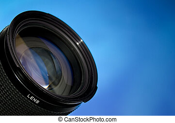 Photograpy lens over abstract blue background.