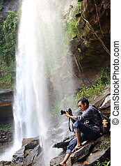 Photography man and waterfall