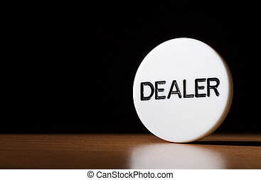 photography of dealer fiches on wood table