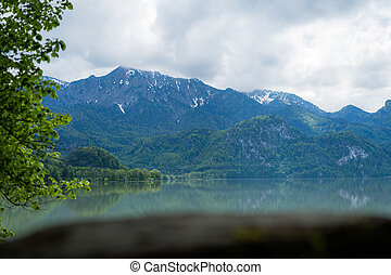 photography of lake with mountain in background