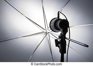 Photography set up with umbrella reflecting modeling lamp
