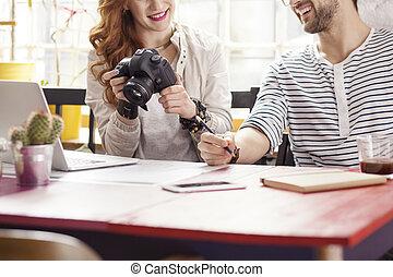 Photography students looking at camera