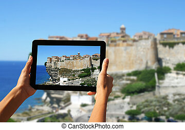 photography with tablet - Girl taking pictures on a tablet ...