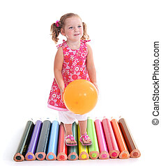 Photomontage of little girl with balloon walking on crayons