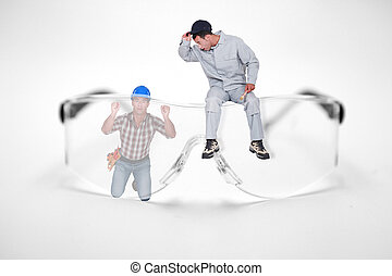 Photomontage of workers with giant goggles saftey glasses