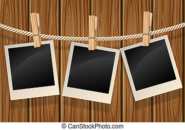 Photos hanging on a clothesline - Blank photos hanging on a...