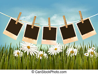Photos hanging on a rope in front of a nature summer background. Vector.