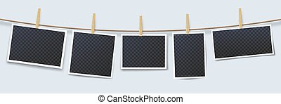 Photos hanging on rope attached with clothes pins. Blank instant photo frames with transparent place