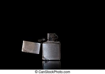 Photos petrol lighter on a black background