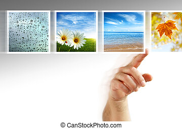 photos touchscreen - human hand scrolling images in a touch...