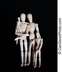 Photos wooden dolls, happy family with children on black background
