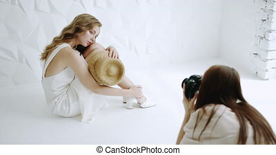 Photosession in Progress - Female model dressed in white...