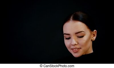 Photosession. Portrait of young pretty woman model. Dark...
