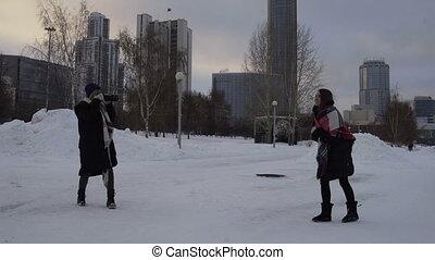 Photoshoot girl on street in winter.