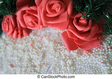 Photoshoot of roses on background sand. Valentine's day