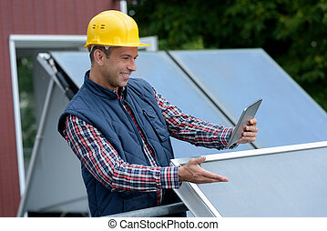 photovoltaic installer testing the installed product