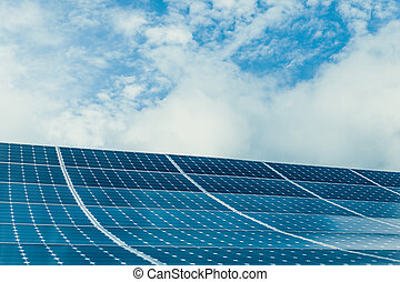 Photovoltaic modules of huge solar panels with clear sky on background