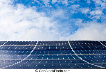 Photovoltaic modules of solar panels with sky on background...