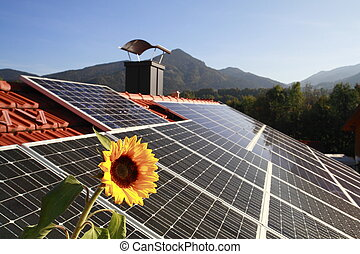 Photovoltaic on roof - Photovoltaic panel on roof with sun...