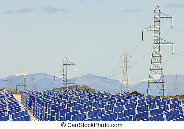 Huge solar field and high tension poles