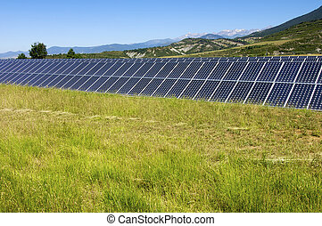 Photovoltaic panels - Solar field with blue sky